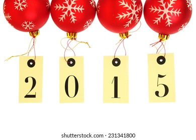 New year 2015 on tags hanging on red Christmas balls