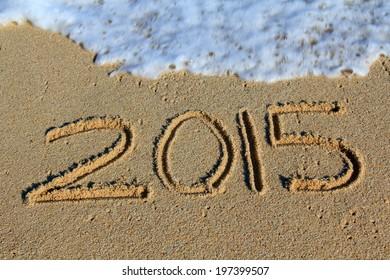 New Year 2015 written in the sand on the beach.