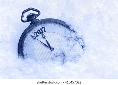 New Year 2017 greeting card, 2017 new year, pocket watch in snow, happy new year concept