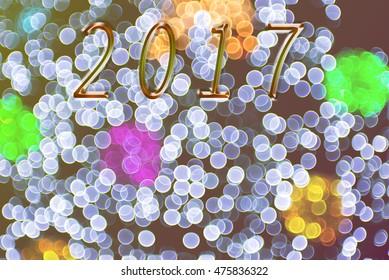 New Year 2017 on beautiful Abstract blurred bokeh light on bright colors