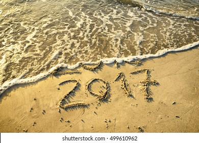 New Year 2017 written on the beach