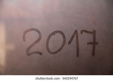 New Year 2017 written on the glass