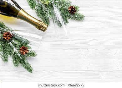 New Year 2018 celebration with spruce branch, champagne and glasses white table background top view mock up