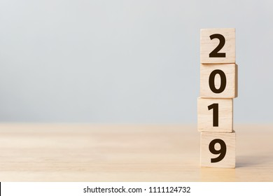 New year 2018 change to 2019 concept. Wooden block cube with number on table
