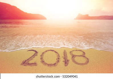 New Year 2018 is coming concept. wave coming to 2018 concept on the sand beach in the morning