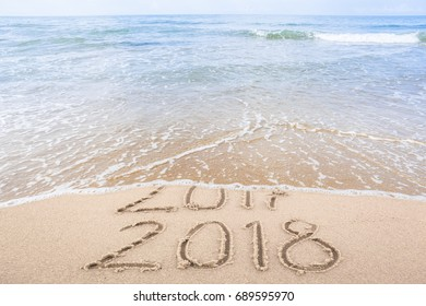 New Year 2018 is coming concept. Happy New Year 2018 replace 2017 concept on the sea beach