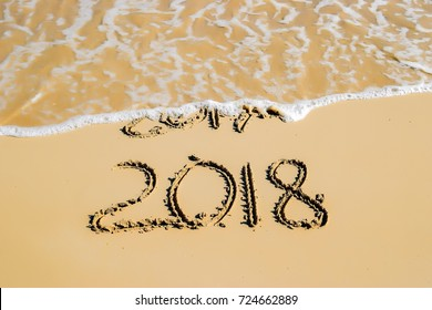 New Year 2018 is coming concept - write 2018 on a beach sand