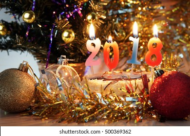 New Year 2018 composition. Holiday decorations and burning candles as numbers