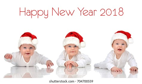 New Year 2018 concept. Collage of infant child baby girl lying in red christmas santa hat happy smiling isolated on a white background