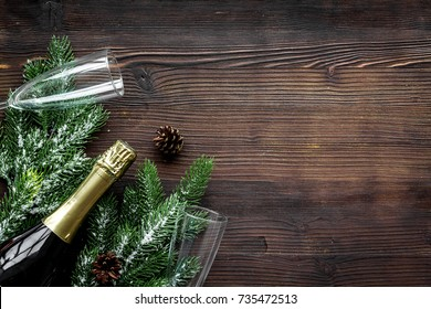 new year 2018 design with spruce, champagne bottle and glasses on wooden table background top view space for text