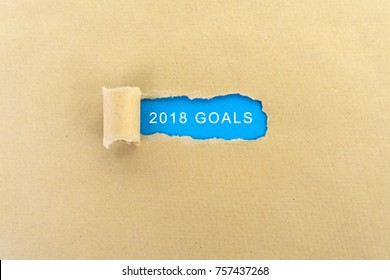 New year 2018 goals word on torn paper