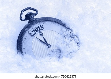 New Year 2018 greeting card, 2018 new year, pocket watch in snow, happy new year concept