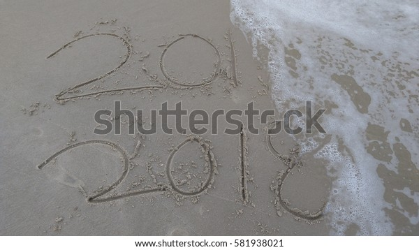 New Year 2018 replace 2017 on sea beach summer, New Year 2018 is coming concept. Closeup.