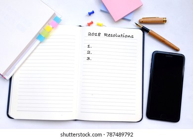 New year 2018 Resolutions Gold Setting Concept book white background