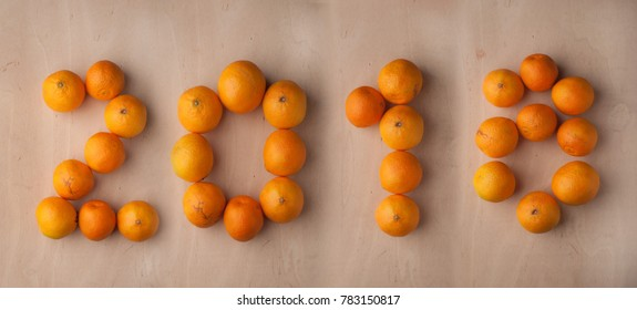 The new year 2018, the tangerines on wooden background