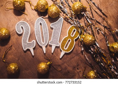 New year 2018 wood number  on wooden plank table at blur abstract  bokeh background . Merry Christmas and Happy New Year 2018 decorations . 2018 Happy new year. Gold Numbers Design of greeting card. G