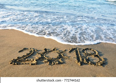 New Year 2018 written on sandy beach at beautiful tropical destination