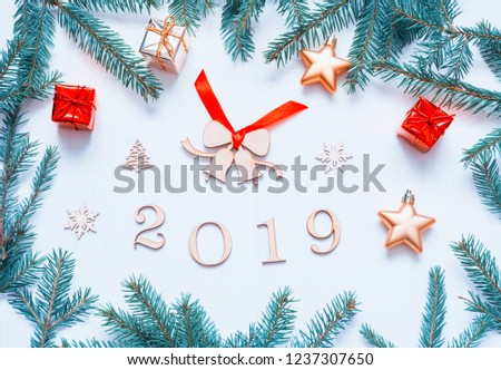 new year 2019 background with 2019 figures christmas toys fir branches flat lay