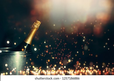 New Year 2019 Celebration Concept. Bottle of champagne on a background of holiday lights