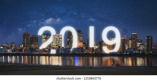 New Year 2019 in the city. Panoramic city at night with starry sky and happy new year 2019 celebration