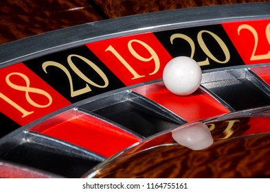 New Year 2019 classic casino roulette wheel with lucky red sector eighteen 19 and white ball and sectors 20, 18