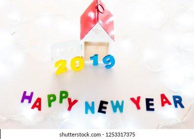 New Year 2019 is coming concept. Happy New Year 2019. Symbol from number 2019 and Home mock up on white background. Home Concept : Buy, Sale, Rent, Investment, Mortgage, Loan, Financial, Renovate