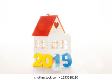 New Year 2019 is coming concept. Happy New Year 2019. Symbol from number 2019 and Home mock up on white background. Home Concept : Buy or Sale Real Estate in 2019