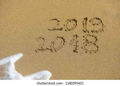 New Year 2019 concept. The inscription on the sand a number message Year 2018 replace 2019