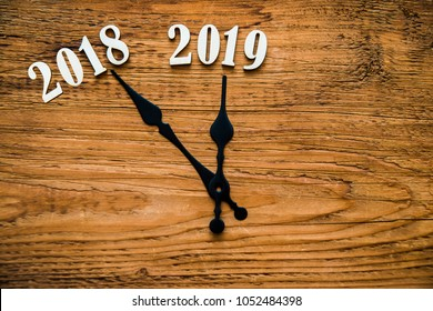 new year 2019 lie on wooden clock face - dial. the end of 2018. Happy new year 2019. holiday time background. Empty copy space for inscription or other objects. merry christmas