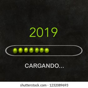 "New Year 2019 ""loading"" text in Spanish. Spanish tradition to eat 12 grapes at midnight"