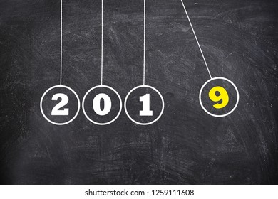 New Year 2019 Newton's Cradle on Chalkboard