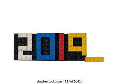 New year 2019 with plastic bricks colerful assembly, one brick  loose, white background