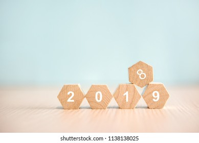 New year 2019 replace 2018 on wood block, Pastel style, background copy space.