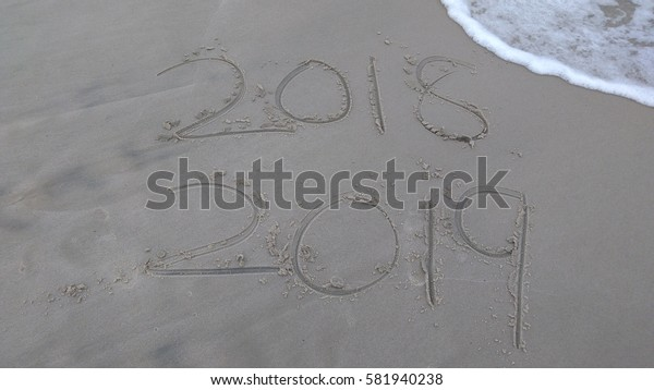 New Year 2019 replace 2018 on sea beach summer, New Year 2019 is coming concept. Closeup.