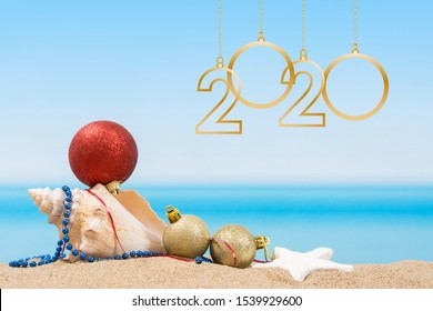 new year 2020. Christmas tree decorations on the beach in tropical. Concept of new year holiday in hot countries