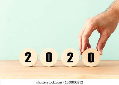 New year 2020 concept. business idea over wooden board