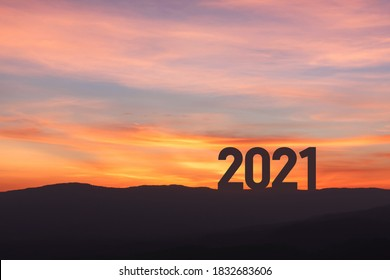 New year 2021 concept with sunset sky and mountain background, Silhouette style
