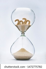 New Year 2021 concept. Time running out concept with hourglass falling sand from 2020.