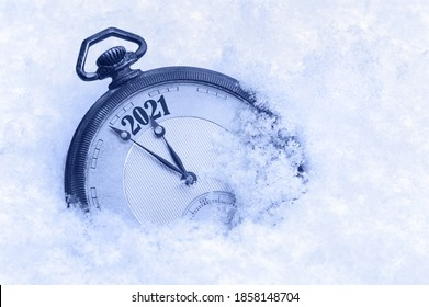 New Year 2021 greeting card, 2021 new year, pocket watch in snow, happy new year concept, countdown to midnight