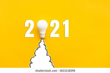 New year 2021 Ideas,inspiration concepts with rocket light bulb on yellow background.Business start up or goal to success.creativity of human