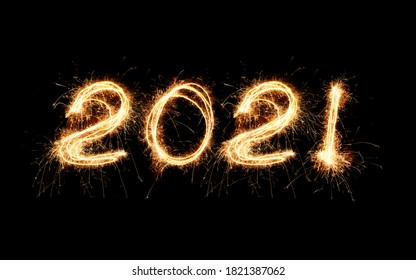 New Year 2021 light. Sparklers draw figures 2021. Bengal lights and letter