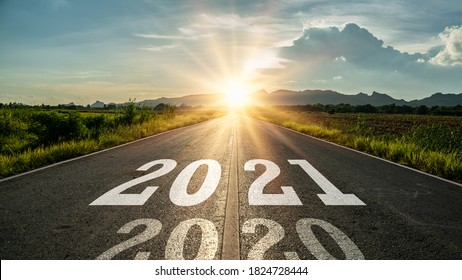 New year 2021 or start straight concept.word 2021 written on the road in the middle of asphalt road at sunset.Concept of planning and challenge or career path,business strategy,opportunity and change - Shutterstock ID 1824728444