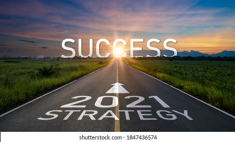 New year 2021 or start straight concept.word 2021 and strategy written on the road of asphalt road at sunset.Concept of target and challenge or career path,success business,opportunity and change