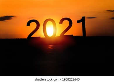 New year 2021 text concept with sunset sky and mountain background,