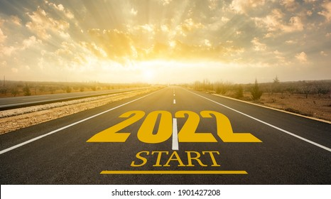New year 2022 or start concept.Word 202 written on the road in asphalt road at sunrise. New life change 2022 plan concept