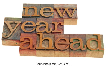 New Year ahead - alert in vintage wooden letterpress printing blocks isolated on white