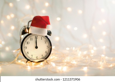 New Year alarm clock with red hood on top. Midnight. Festive Chritmas background