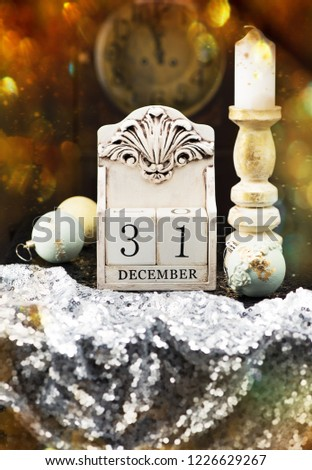 new year background 31 december wooden calendar vintage christmas balls and candle