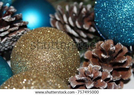 new year background from a branch of pine cones gold and blue christmas balls