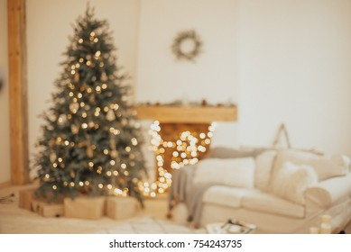 New Year background. Christmas Room Interior Design, Xmas Tree Decorated By Lights Presents Gifts Toys, Candles And Garland Lighting Indoors